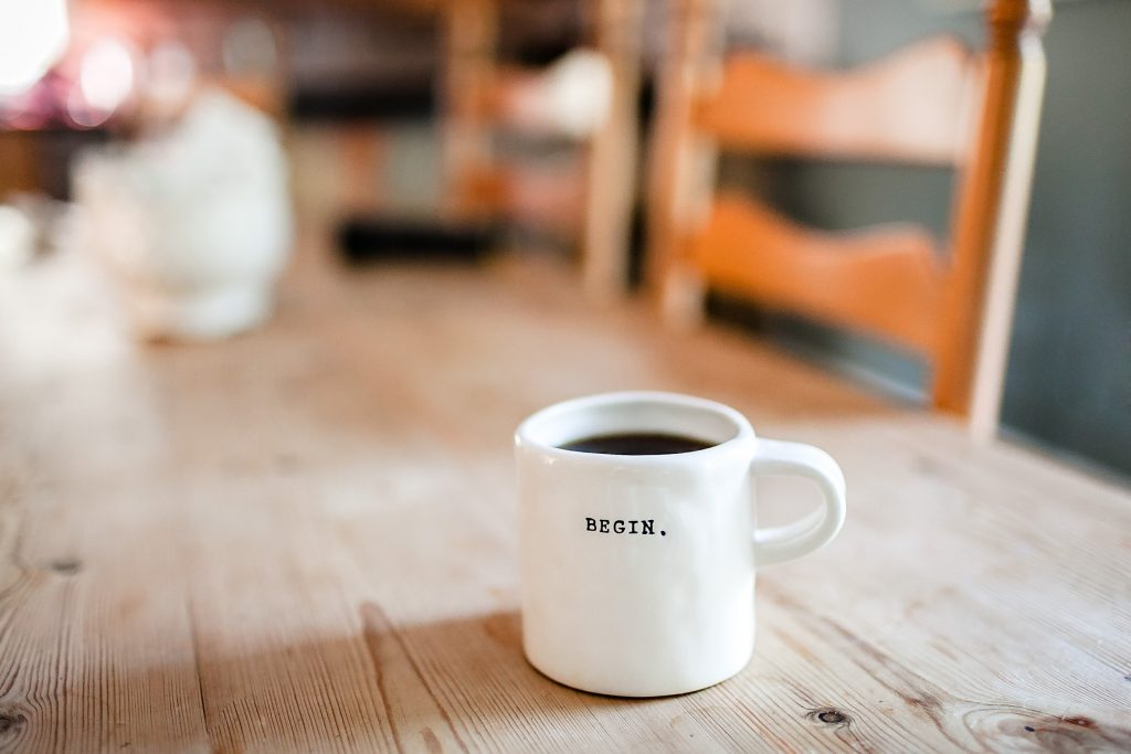 Excellent.org: a cup of coffe with the word begin. on it
