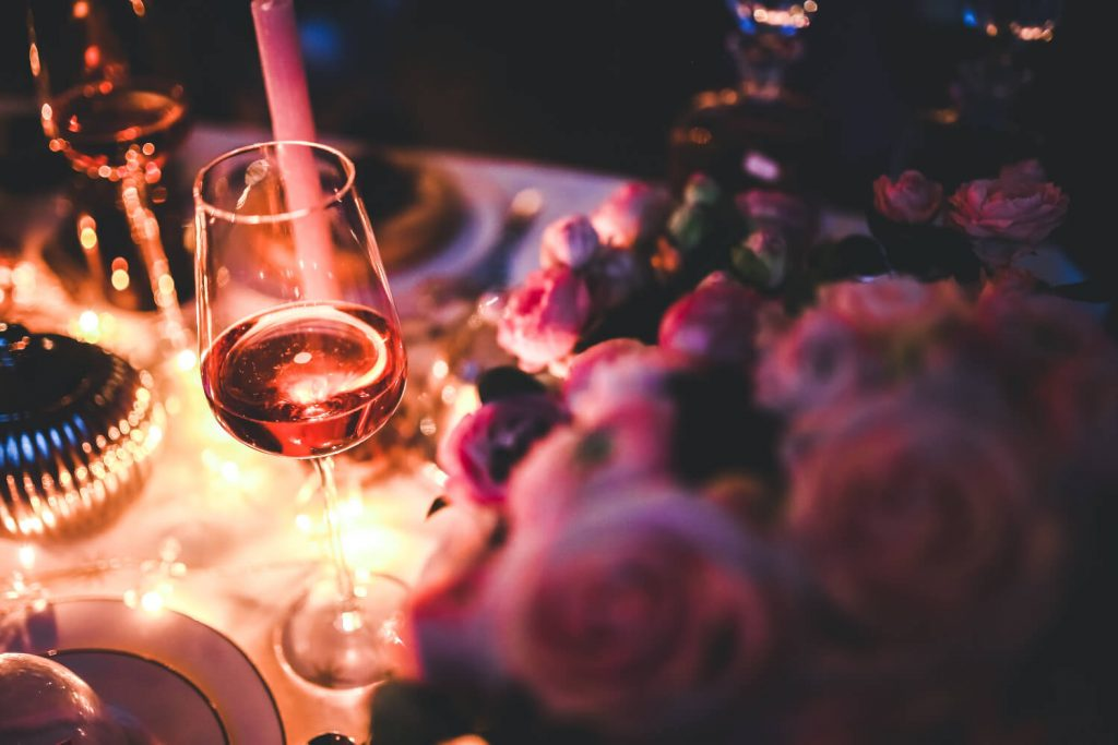 Excellent.org gives examples of how to integrate Valentines Day on your website, the picture shows a set table with a glass of wine