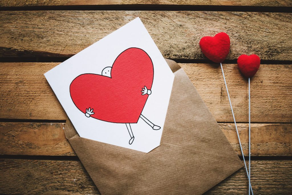 Excellent.org gives examples of how to integrate Valentines Day on your website, the picture shows an envelope that has a letter with a heart on it in it