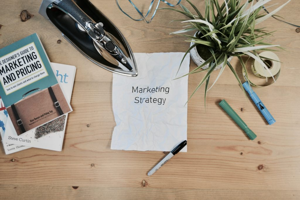 Excellent.org: a paper on a table with the word marketing strategy on it
