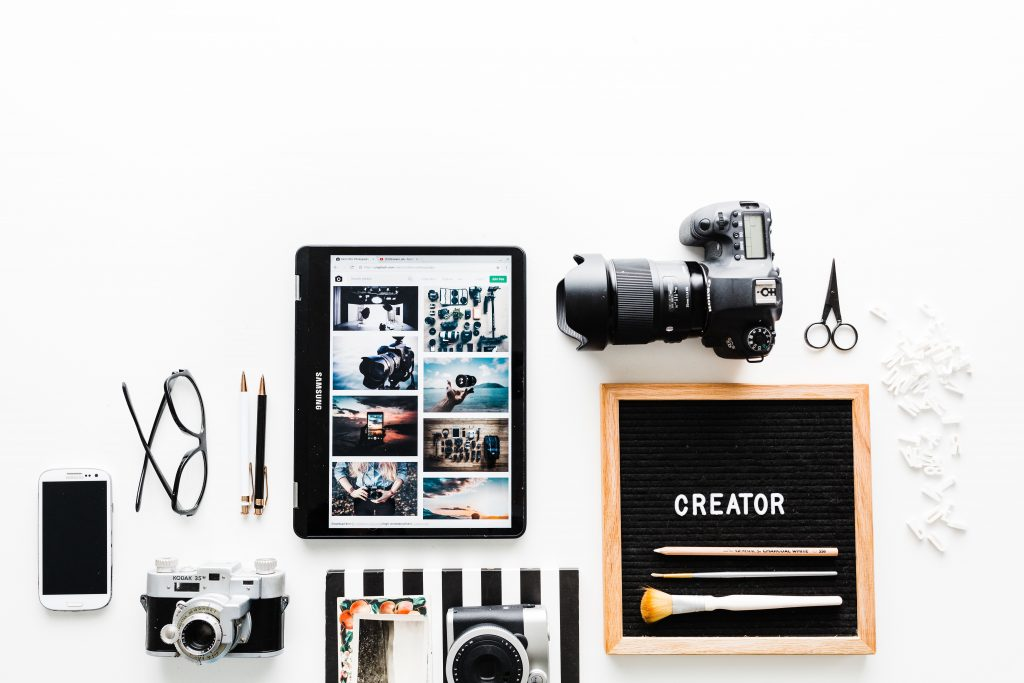 Excellent.org: advices like cameras, phone and a tablet on a table: Things to create content