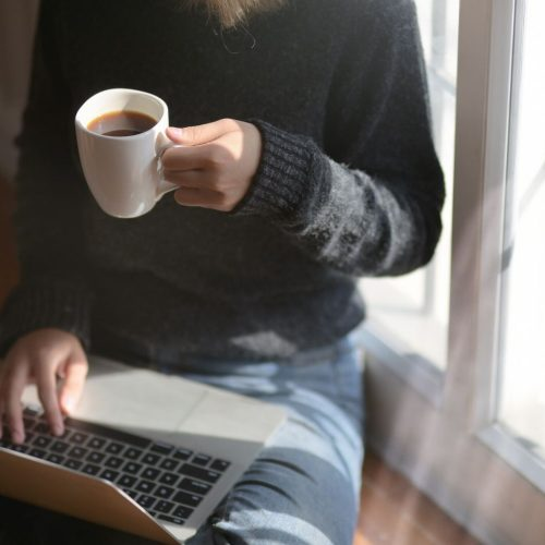 Excellent.org talks about the relevance of a good work-life balance and gives tips on how to balance work and private life, the picture shows a person casually working on a laptop on the floor